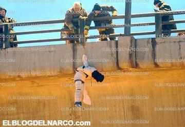 Fotografías un de ejecutado, envuelto en vendas y colgando de puente en Iztapalapa